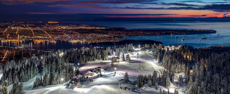 The Peak of Vancouver City. Stunning views from Grouse Mountain Ski Resort at Dusk, British Columbia, Canada.