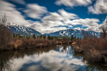Whistler and Blackcomb mountains from The River of Golden Dreams. Whistler, BC, Canada.