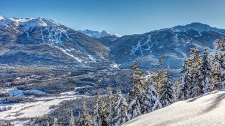 Whistler Blackcomb Mountains in Winter after a fresh snowfall on a sunny blue sky day. British Columbia, Canada