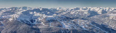 Panoramic view of Whistler Mountain on a Snowy winter day from Blackcomb Mountain. 写真素材