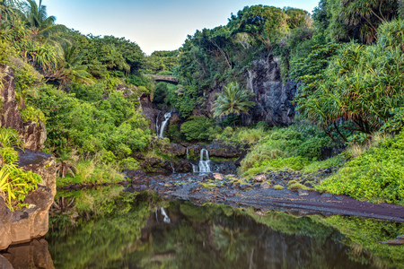 Lush , Tropical and Calm reflection in the morning at oheo gulch or seven pools , Haleakala National Park on the East side of Maui, Hawaii. Stock fotó