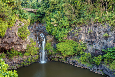 Gentle waterfall under the bridge at the Lush Oheo Gulch, Haleakala National Park.  Just past the town of Hana on the east side of Maui, Hawaii