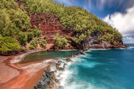 The Spectacular Red Sand Beach in the town of Hana on the tropical Island of Maui, Hawaii, USA