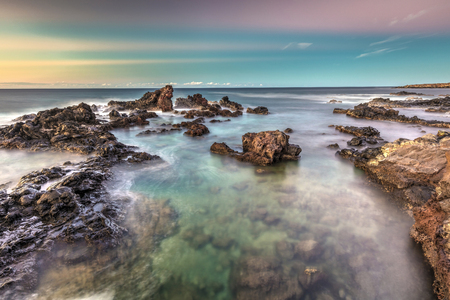 Long exposure taken at Hookipa beach on the Island of Maui, Hawaii at Dusk Stock Photo