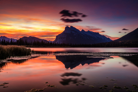 Mount Rundle Glorious Sunrise from the shore of the Vermillion Lakes in Banff National Park, Alberta, Canada.