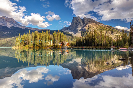 Perfect reflection of Emerald lake lodge cabins at Emerald Lake in Yoho National Park, British Columbia, Canada
