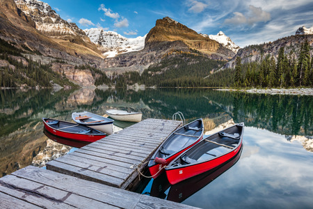 Summertime in the Canadian Rockies. A peaceful and stunning reflection, in the early morning hours at lake OHara in yoho national park