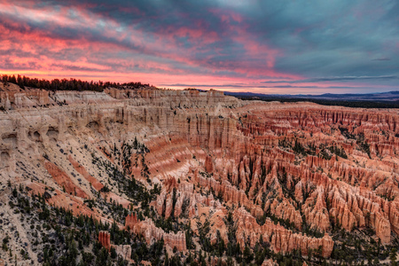Sunset at Bryce Point. colors in the clouds and sky over the incredible landscape at the scenic Bryce point in Bryce Canyon National Park, Utah