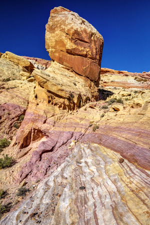 colorful layers of sandstone and rock formations in the desert of Valley of Fire, Nevada