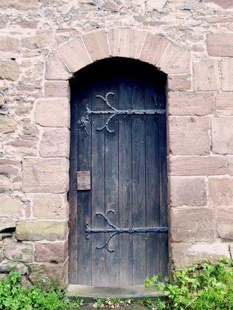 tudor: An old door within a striking doorway arch in a Tudor building Stock Photo