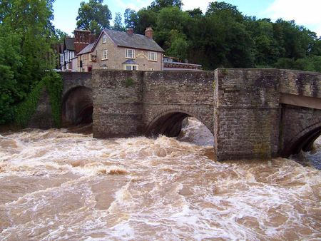 witnesses: A medieval stone bridge witnesses another flood