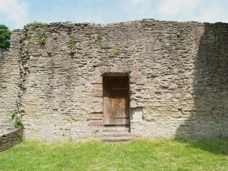 A doorway in a ruined castle wall now leads to nowehere