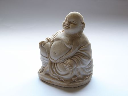 stone buddha: A white stone Buddha in soft light