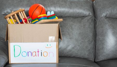Toy donation box to deliver these items to those who are lacking or those who suffer disaster in various places around the world. Standard-Bild - 132606829