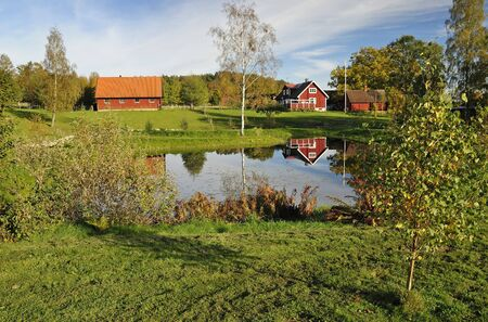Swedish autumn landscape with water reflection