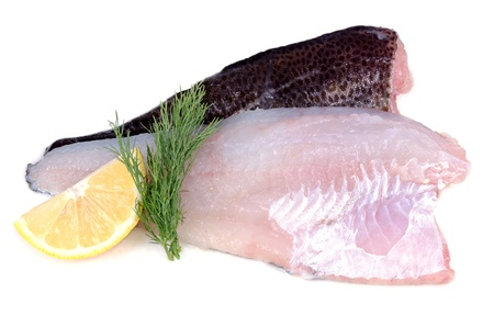 Raw cod fish fillets with citron and dill  photo
