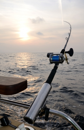 Single fishing-rod on a boat photo