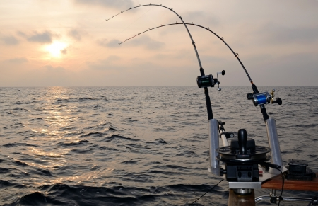 trolling: Big game fishing at sunset Stock Photo