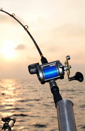 trolling: Closeup for fishing-rod at sunset  Stock Photo