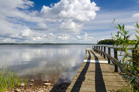 Swedish wooden bridge on the lake  photo