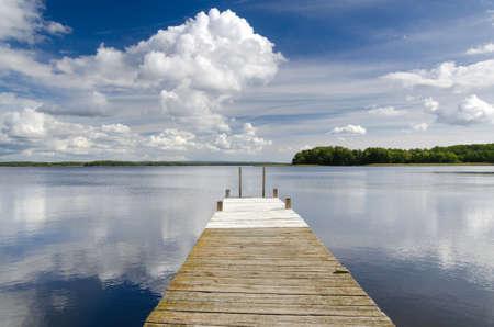 Wooden lake bridge in summer season
