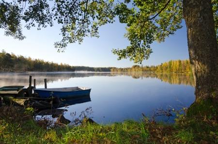 Idyllic lake landscape in foggy morning