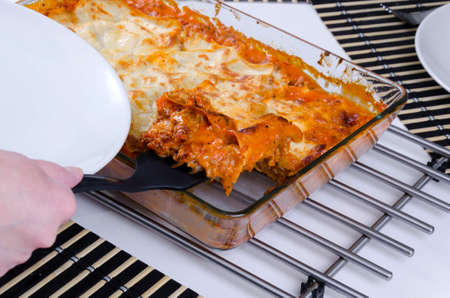 Sharing process of home made lasagna Stock Photo - 17754331