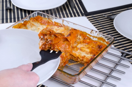 Lasagna slice sharing on plate Stock Photo - 17754327