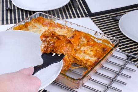 Lasagna slice sharing on plate Stock Photo - 17754327