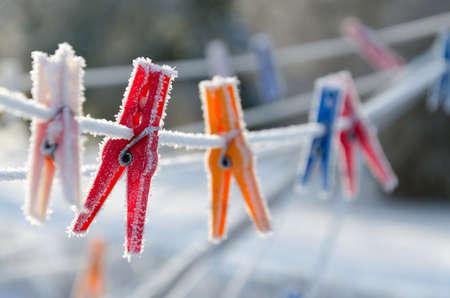 winter garden: Multicolored clips on line in winter garden Stock Photo