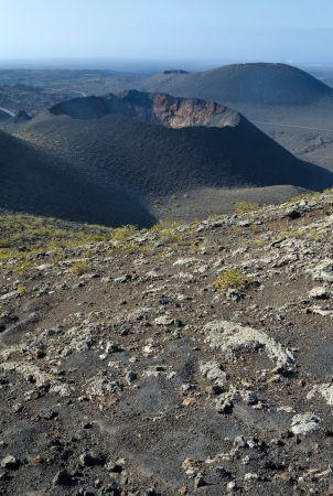 Lanzarote volcano crater in vertical landscape photo