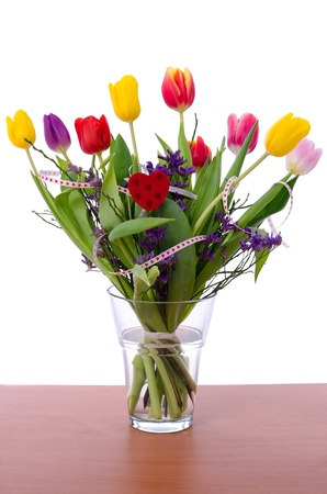 Beautiful tulip bouquet on a table photo