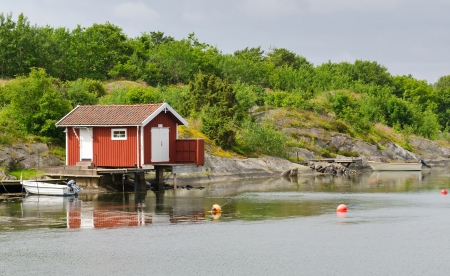 Swedish sea coast with typical cottage photo