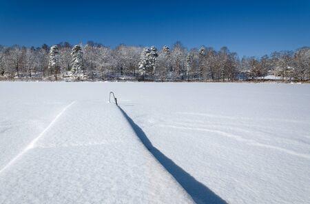 Lake bridge in winter season photo