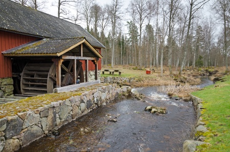 Swedish landscape with watermill photo