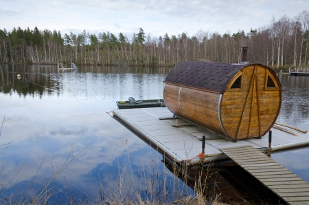 Sauna house on a lake bridge Standard-Bild
