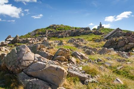 headland: Lighthouse on the top of rocky coast