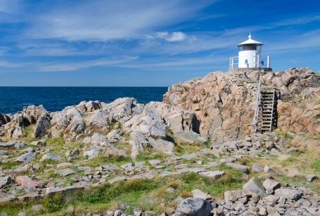 Small lighthouse on the top of Kullen peninsula Stock Photo
