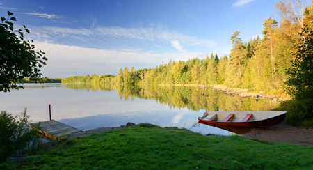September panorama landscape of Swedish lake photo