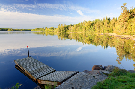 Swedish lake in september morning light photo