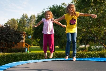 Fun with garden trampoline Stock Photo