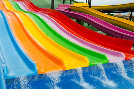 Colorful slides in tropical outdoor park photo