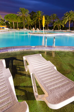 Tropical swimming pool area in vertical view  photo