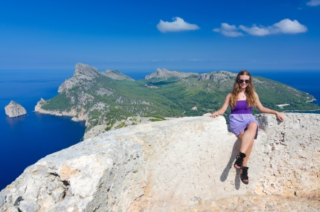 Happy teenage girl on the hills top on Majorca island  photo