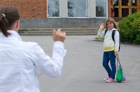 ways to go: Waving goodbye before the school