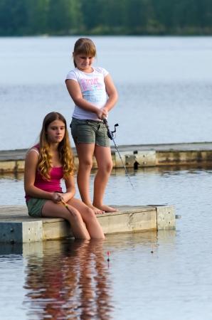 Girls fishing photo