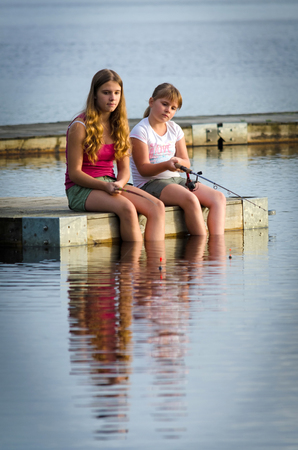 Sisters fishing together  photo