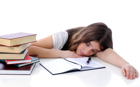 Tired teenager sleeping after learning  photo