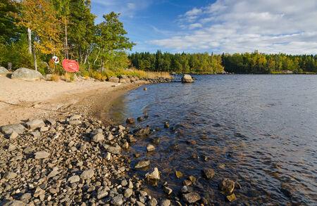 lake beach: Typical Swedish lake beach in autumn season