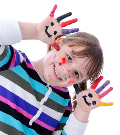 Adorable child girl have paint with painting photo